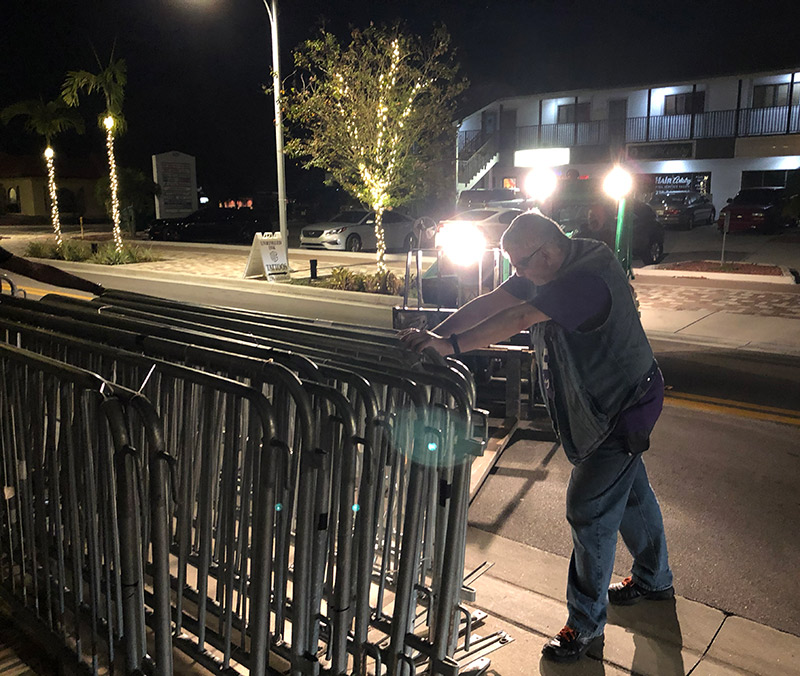 Joe holding up barricades.