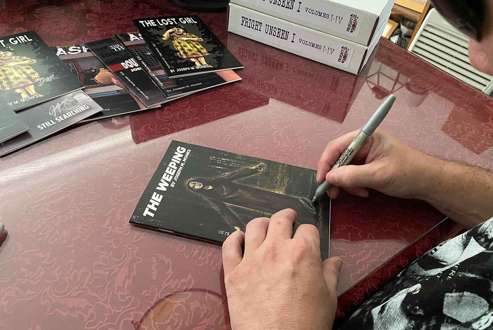 Joe signing The Weeping